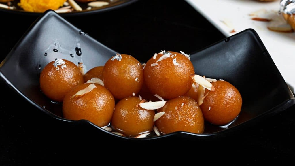 Gulab Jamun is very famous dessert in indian